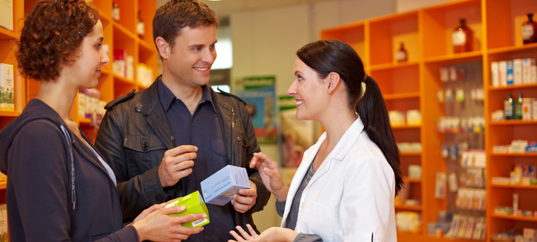 pharmacist showing a medicine on a patient